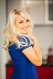 Blonde girl with beautiful smile and eyes in blue Royalty Free Stock Photography