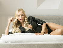 Blonde girl on the bed Royalty Free Stock Photography
