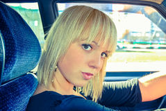 Blonde girl behind the wheel of a car Royalty Free Stock Photography