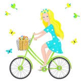Blonde girl on a bicycle Royalty Free Stock Photography