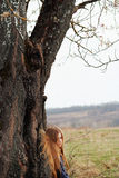 Blonde girl and big tree Royalty Free Stock Images