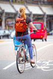 Blonde girl on bike path in Amsterdam Royalty Free Stock Photos