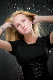 Blonde girl in black dress and wide belt. Shot in studio stock images