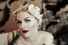 Blonde girl and black feathers Royalty Free Stock Photography