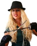 Blonde girl in black hat with two long knife stock photos