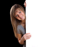 Blonde girl with a blank presentation board. Pretty blonde girl with a blank presentation board Royalty Free Stock Photography