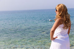 Blonde girl. Looking at sea, Athens Greece stock photo