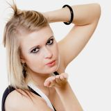 Blonde girl blowing a kiss or with copy space on hand Royalty Free Stock Images