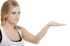 Blonde girl blowing a kiss or with copy space on hand Royalty Free Stock Photography