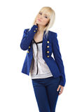 Blonde girl in blue pants and jacket Royalty Free Stock Photos