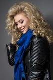 Blonde girl in blue scarf Stock Photo