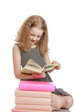 Blonde girl with a book in his hands Stock Photography