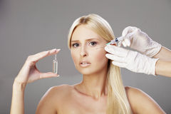 Blonde girl and botox injection 2 Stock Photography