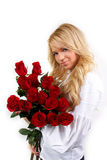 Blonde girl with a bouquet of flowers Royalty Free Stock Images