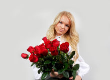 Blonde girl with a bouquet of flowers Stock Photography