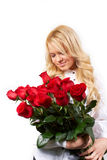 Blonde girl with a bouquet of flowers Royalty Free Stock Photos