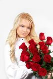 Blonde girl with a bouquet of flowers Stock Photo