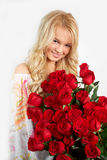 Blonde girl with a bouquet of flowers Royalty Free Stock Image