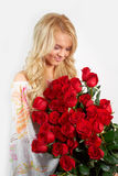 Blonde girl with a bouquet of flowers Royalty Free Stock Photo