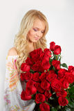 Blonde girl with a bouquet of flowers. Young blonde girl with a bouquet of flowers Royalty Free Stock Photo