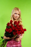 Blonde girl with bouquet roses Stock Images
