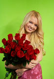 Blonde girl with bouquet roses Royalty Free Stock Photos