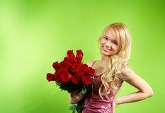 Blonde girl with bouquet roses Stock Photography
