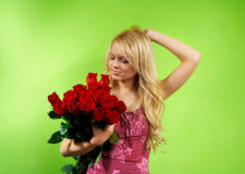 Blonde girl with bouquet roses Royalty Free Stock Photography