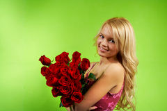 Blonde girl with bouquet roses Stock Photo