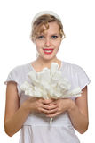 Blonde girl with a bouquet of white paper roses Royalty Free Stock Photo