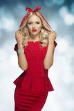 Blonde girl with bow on head Royalty Free Stock Photos