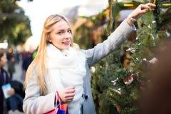 Blonde girl buying Xmas tree Stock Image