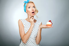 Blonde girl with cake Royalty Free Stock Photo