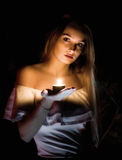 Blonde girl with candle in hand Royalty Free Stock Image