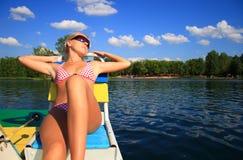 Blonde girl on catamaran Stock Photos