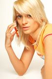 Blonde girl with cell phone. Close up stock photos