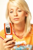 Blonde girl with cell phone. Close up royalty free stock photo