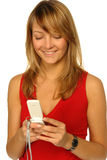 Blonde girl with cell phone stock photography