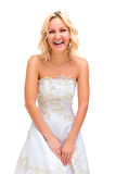 Blonde girl cheerfully laughs in a wedding dress Royalty Free Stock Photo