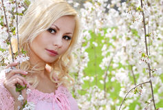 Blonde Girl with Cherry Blossom Stock Images