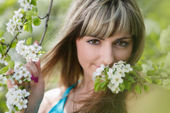 Blonde Girl with Cherry Blossom Royalty Free Stock Photo