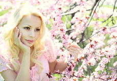 Blonde Girl with Cherry Blossom. Spring Portrait Royalty Free Stock Photos