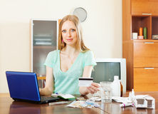 Blonde   girl choosing medication in online pharmacy Royalty Free Stock Images