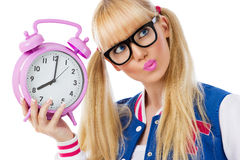 Blonde girl with clock Stock Photography