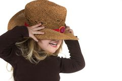 Blonde Girl in Cowgirl Hat. A little blonde girl playing in a cow girl hat Royalty Free Stock Images