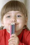 Blonde girl with crayon. Stock Images