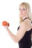 Blonde girl curling Stock Image