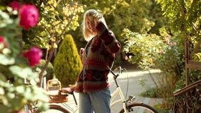 Blonde girl dancing. Disco hair concept. Autumn woman with autumnal mood. Autumn happy people and joy. Hello Autumn bye stock video footage