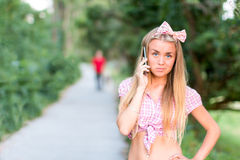 Blonde girl at a date and making a call Royalty Free Stock Images