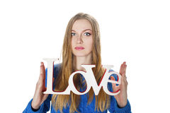 Blonde girl with decorative word love Royalty Free Stock Image